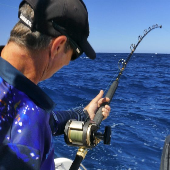 Nick Hocking hooked up to a HUGE Rottnest Island Kingfish