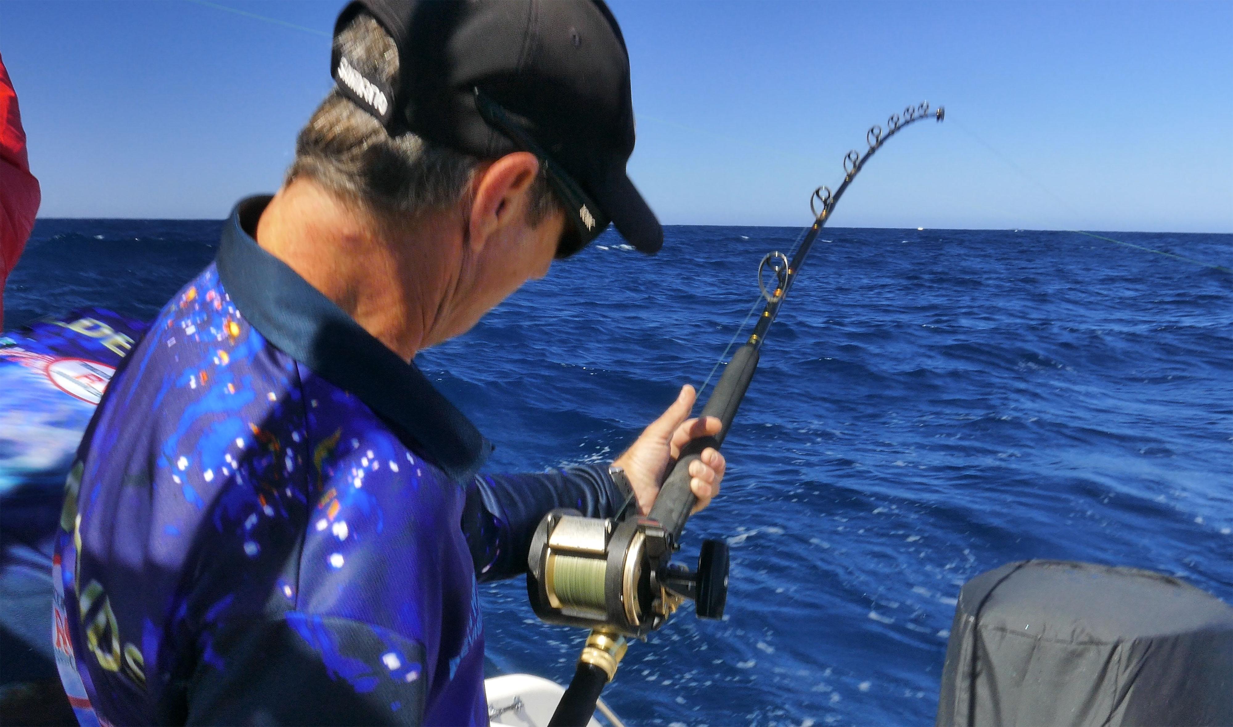 Nick Hocking hooked up to a HUGE Rottnest Island Kingfish